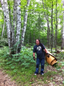 Wayne Valliere, packing canoe bark out of the birch forest, in the summer of 2012. Photo by Tim Frandy