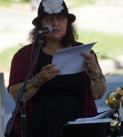 Poet Christina Zadowski reads poetry. Photo © by Lee Matz.