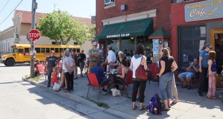 Noon gathering outside of Riverwest Co-op and Café. Photo © by Lee Matz.